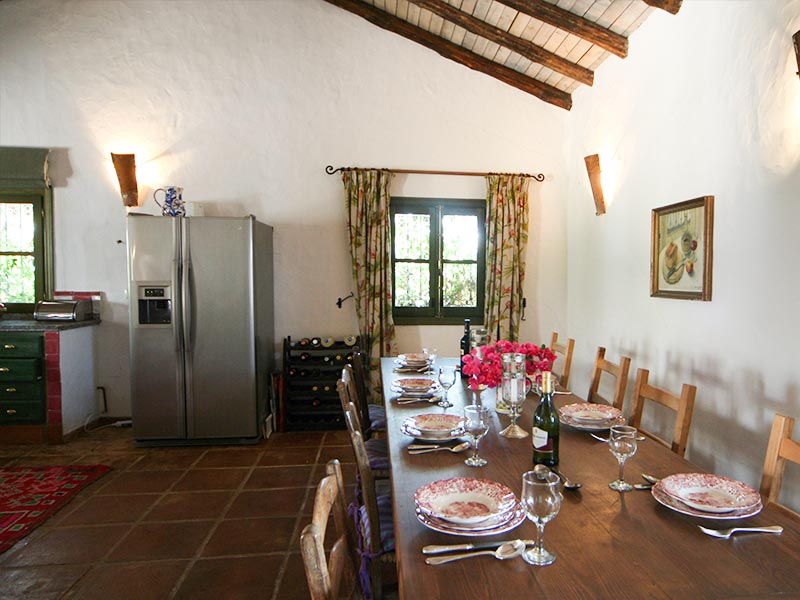 An image of the dining area adjacent to the kitchen