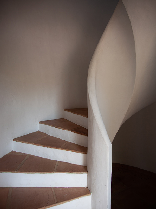 An image of the stairs to the upstairs salon
