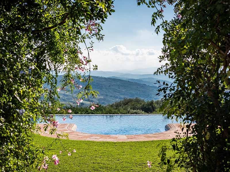 An image of the infinity swimming pool looking down the valley